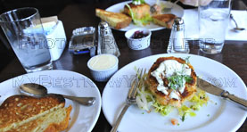 Delicious Salmon cakes with frisee salad at restaurant James, Brooklyn, NY